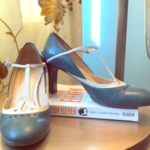 Teal and cream t-strap pumps with 3-inch heel.